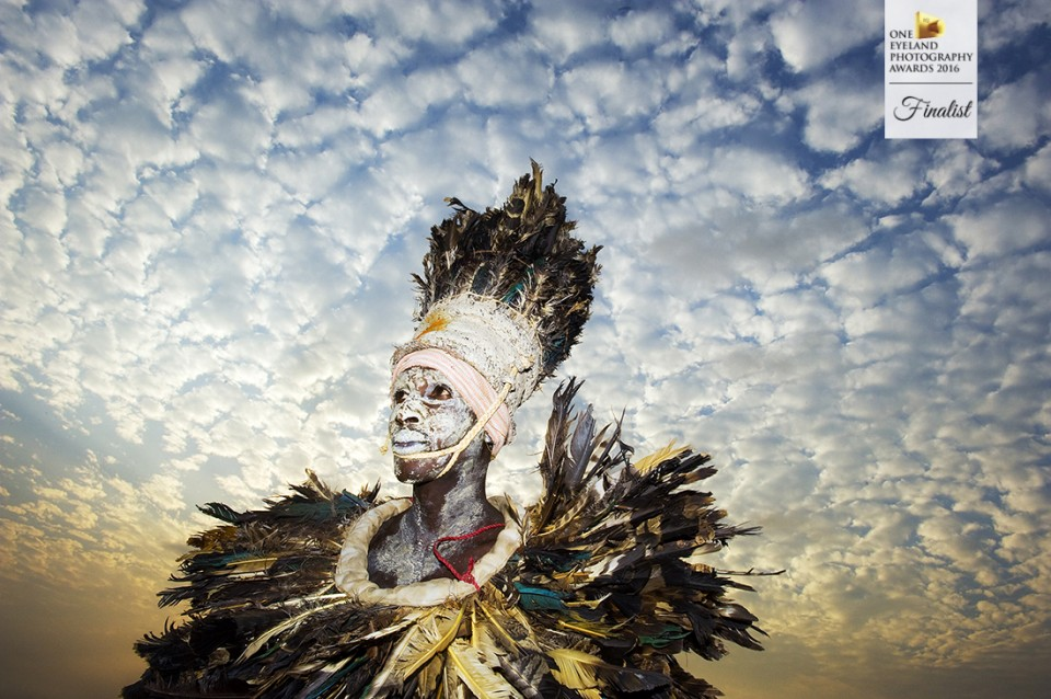 West African tribal dancer waiting to perform at the Liberia Nat